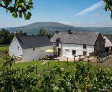 Snaptrip - Last minute cottages - Delightful Abergavenny Cottage S40132 - Sugar Loaf Farm House Exterior Web Jpeg-