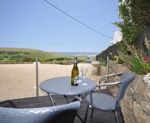 Snaptrip - Last minute cottages - Splendid Burton Bradstock Cottage S43199 - burton bay altered patio june 2015