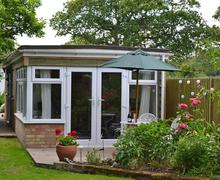 Snaptrip - Holiday cottages - Exquisite Pilley Lodge S58942 - The Lodge 1