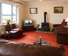 Snaptrip - Last minute cottages - Gorgeous Amroth Apartment S43744 - apartment amroth lounge gas wood burner