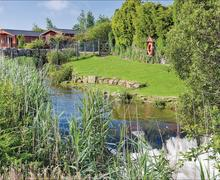 Snaptrip - Last minute cottages - Lovely Relubbus Lodge S79304 - The park setting
