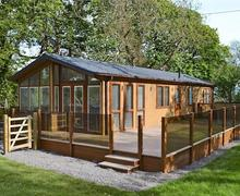 Snaptrip - Holiday cottages - Excellent Benllech Lodge S81230 -