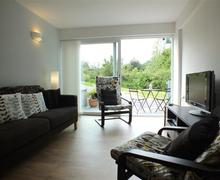 Snaptrip - Last minute cottages - Quaint Tresaith Apartment S71687 - 726-0-sitting-room-to-garden