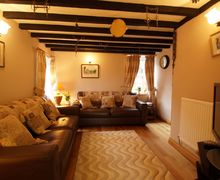 Snaptrip - Last minute cottages - Cosy Henryd Cottage S57825 - Welcoming lounge - perfect for a relaxing holiday in Conwy