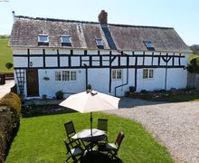 Snaptrip - Last minute cottages - Cosy  Cottage S57971 - Cosy Mid Wales cottage (left), back of owner's farmhouse on the right