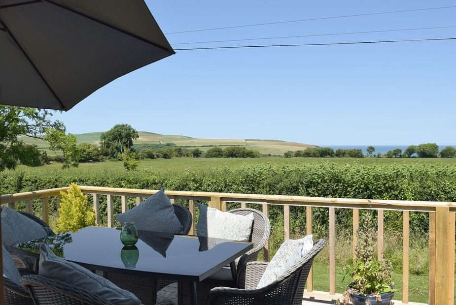 Chalet with sea views at Dinas Country Club