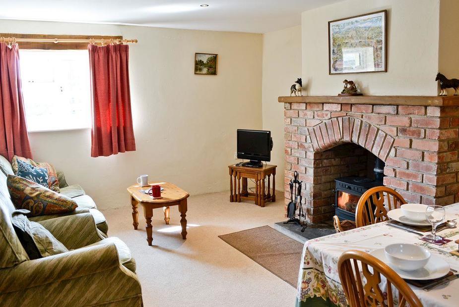 Living room with wood burner | The Granary, Shirwell, near Barnstaple - The Granary