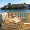 Snaptrip - Last minute cottages - Beautiful Fowey Apartment S44944 - Decked balcony area with outdoor table and chairs, mooring and steps down to the water