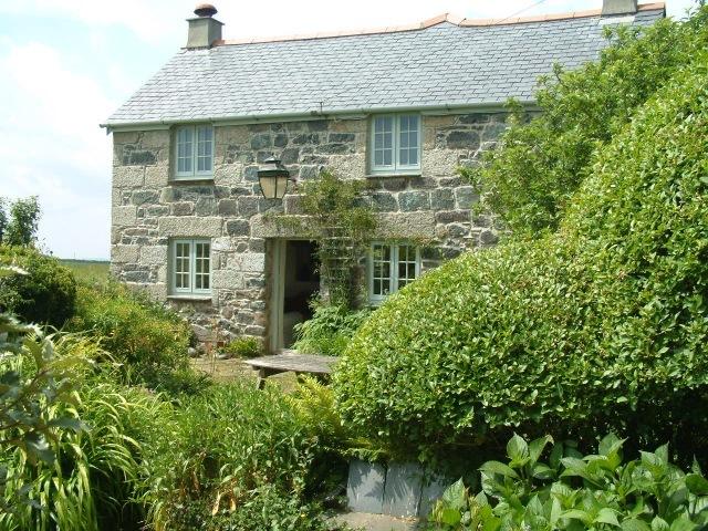 Higher Roskorwell Cottage cottage front onto the garden