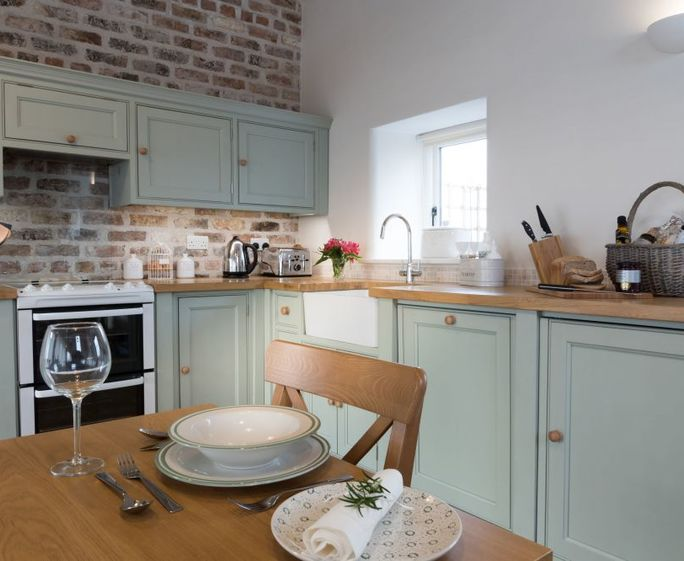 The Cart Shed at Swallow's Nest Hand crafted country kitchen, oak wood flooring and underfloor heating