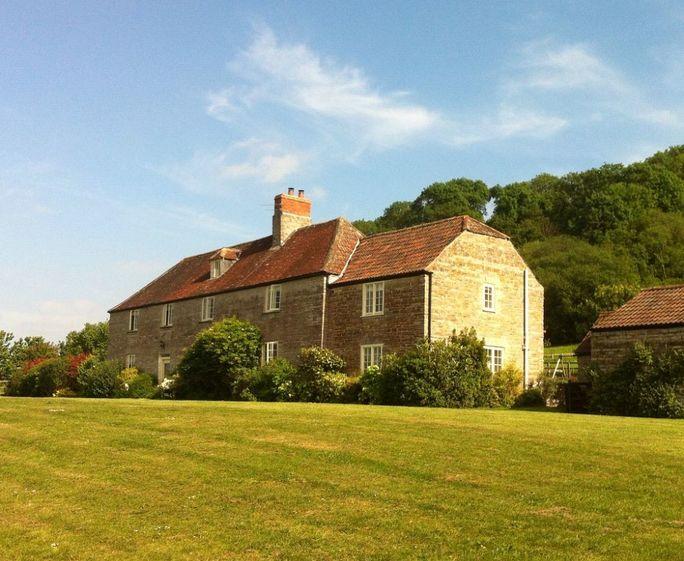 Park Farm West The farmhouse nestles on a hillside beneath Ancient woodland