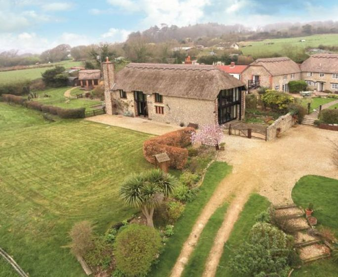 Champernhayes Barn, Wootton Fitzpaine, Nr Lyme Regis Champernhayes Barn is an impressive 15th Century barn that has been restored to original thatch and overlooks a beautiful valley with views of the Charmouth Sea