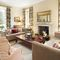East House, Cheswick Ground floor: Drawing room with wood burning stove and garden views