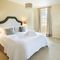 East House, Cheswick First floor: Bedroom one with super king bed and en-suite bathroom