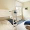 East House, Cheswick First floor: Bedroom five with 3' bunk beds and 3' single bed