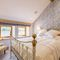 The Great Barn, Ullswater, The Lake District Ground floor: Loadpot - Lake View bedroom with 4'6 double bed with Vispring Elite mattress and en-suite natural stone shower room with walk in monsoon and raindrop shower