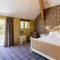The Great Barn, Ullswater, The Lake District Ground floor: Ravenhowe - Lake View bedroom with 5' double bed with Vispring Elite mattress and en-suite natural stone shower room with walk in monsoon and raindrop shower and direct access to Lake View terrace
