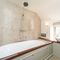The Ottery, Lower South Wraxall, Bradford on Avon First floor: Modern bathroom with shower over the bath