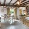 Draenllwynellen, Montgomery, near Newtown Ground floor:  Large, well equipped farmhouse dining kitchen with beamed ceiling, French doors opening onto ornamental garden and patio with bistro style furniture