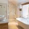 Draenllwynellen, Montgomery, near Newtown First floor: family bathroom with claw foot, free standing bath with shower attachment, twin basin marble topped wash stand, large walk in shower and underfloor heating