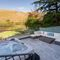 Waternook, Ullswater, The Lake District Infinity terrace including external hot tub, complete with underwater mood lighting and waterfall effect