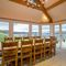 Waternook, Ullswater, The Lake District Ground floor: Dining table and chairs seating 12 and double aspect lake views with french doors opening on to terrace