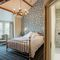 Waternook, Ullswater, The Lake District First floor: Fusedale has a 6' super king bed with Vispring Elite mattress and en-suite natural stone shower room with monsoon and raindrop showers