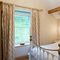 Waternook, Ullswater, The Lake District First floor: Hallin has a 4'6 bed with Vispring Elite mattress and en-suite natural stone shower room with monsoon and raindrop showers and views across Hallin Fell