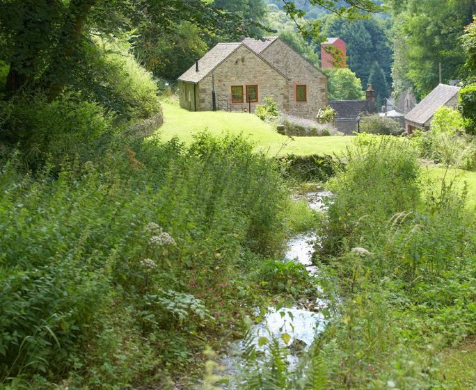 Mill Race Cottage, Bonsall The gardens extend to approximately two acres, the main feature of which is a delightful mill stream which cascades through the gardens over a series of waterfalls, with several small bridges criss crossing the waterway
