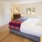 Middle Hollacombe Farmhouse, Hollacombe First floor: Double bedroom with 5' bed with en-suite shower room