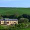 Middle Hollacombe Farmhouse, Hollacombe The Farmhouse is tucked away in a gentle, secluded valley surrounded by traditional Devon farmland and set within its own landscaped garden