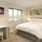 Goldcrest, Kinnerley, near Oswestry Ground floor: Bedroom one with king size bed and en-suite shower room
