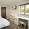 Goldcrest, Kinnerley, near Oswestry Ground floor: Bedroom four with twin beds and en-suite shower room