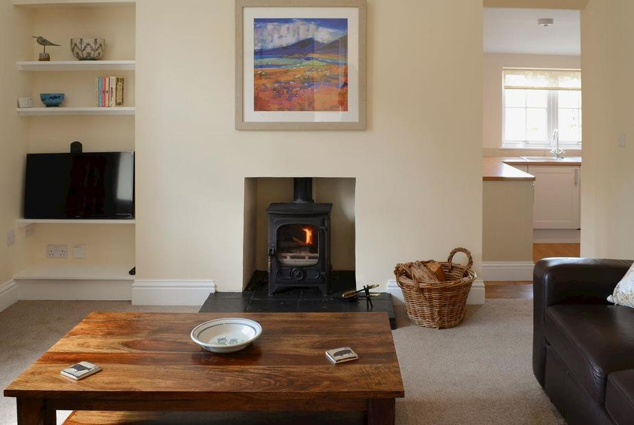 """Maikle Cottage Comfortable lounge with wood burner and 32"""" Freeview TV  