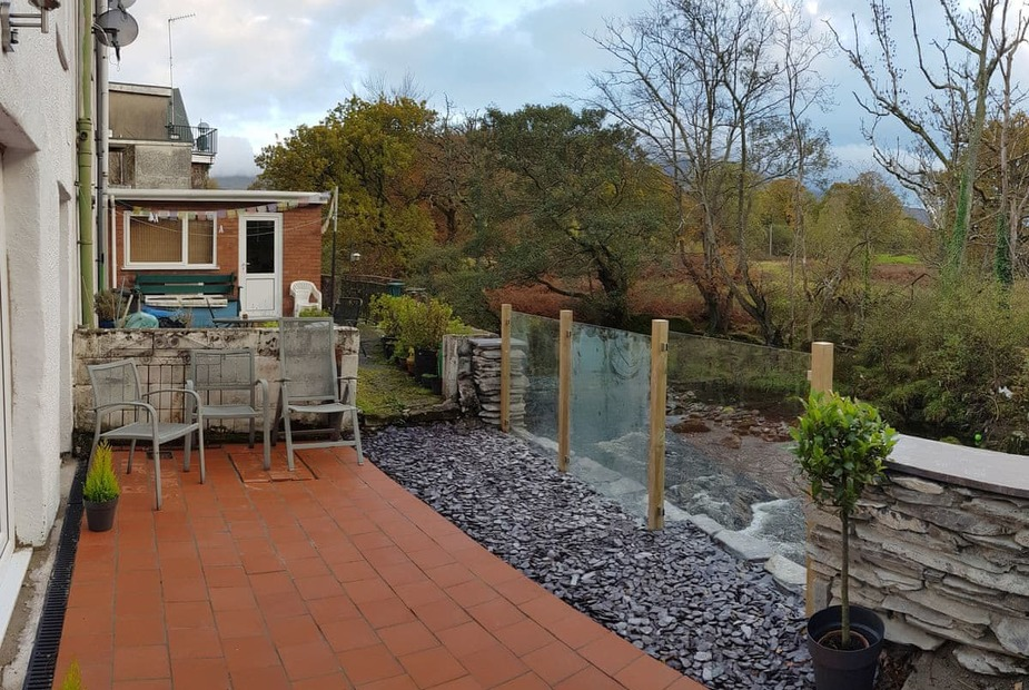 Glanafon Patio area overlooking the river | Glanafon, Bethesda, near Bangor