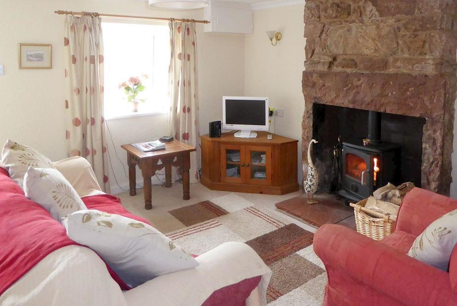 Blake Fell Cottage Characterful living room with original, beautiful sandstone fireplace | Blake Fell Cottage, Asby, near Cockermouth