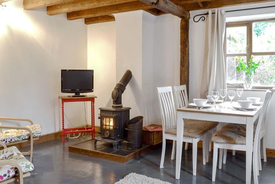 Ty Uchaf Charming, cosy living/ dining room with beamed cieling | Ty Uchaf - Glyngynwydd Cottages and Wedding Barn, Glyngynwydd, near Llanidloes