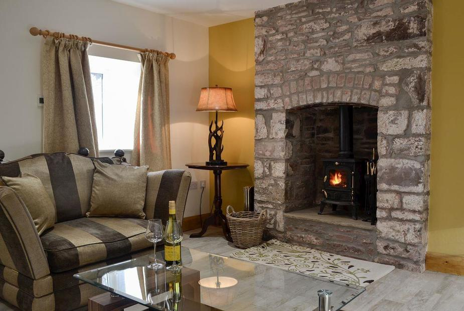 Holly Cottage Cosy living room with wood burner | Holly Cottage, Merthyr Cynog, near Brecon