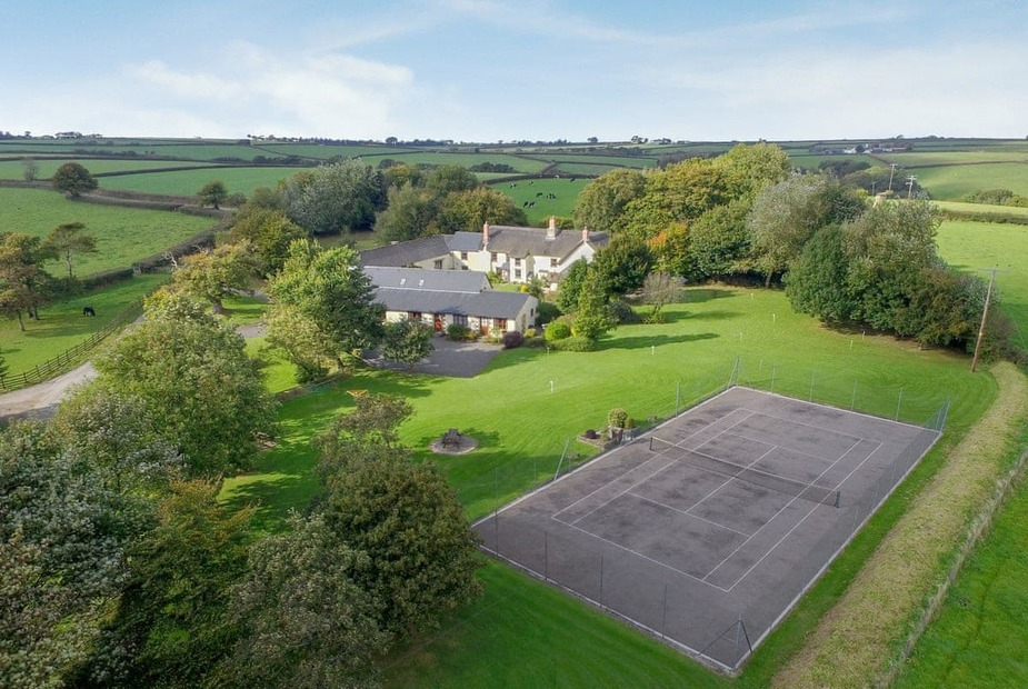 Honeysuckle Cottage - W8224 Aerial view of the 3 acres of meadows, lawns, tennis court, and putting course | Honey Suckle Cottage, Ashreigney, near Great Torrington
