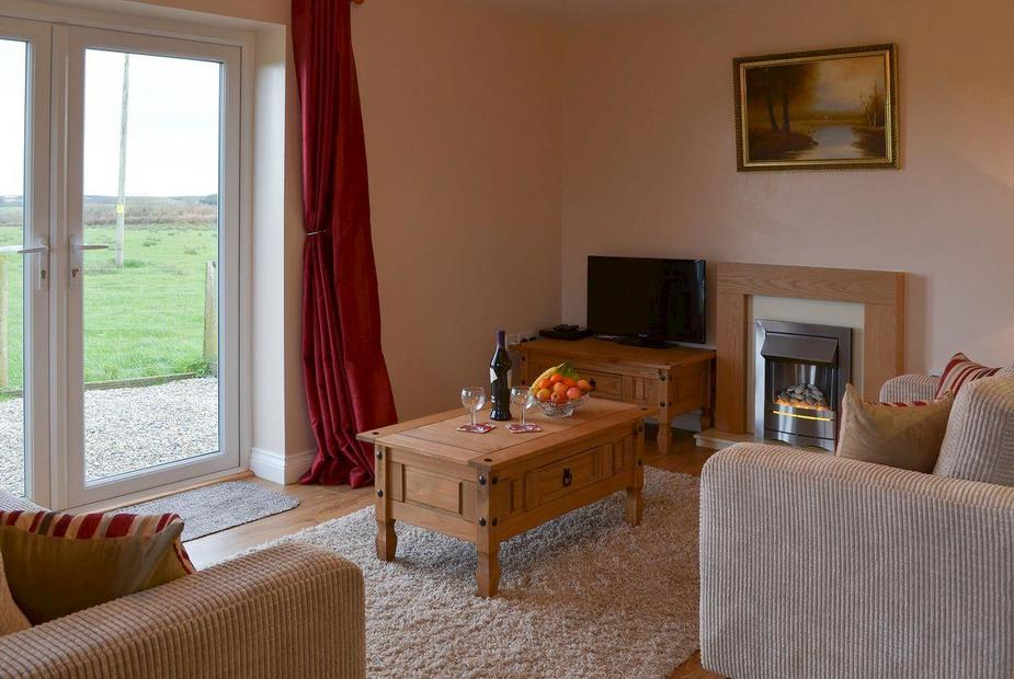 West View Cottage Living room with patio doors | West View Cottage, Woolley, near Bude