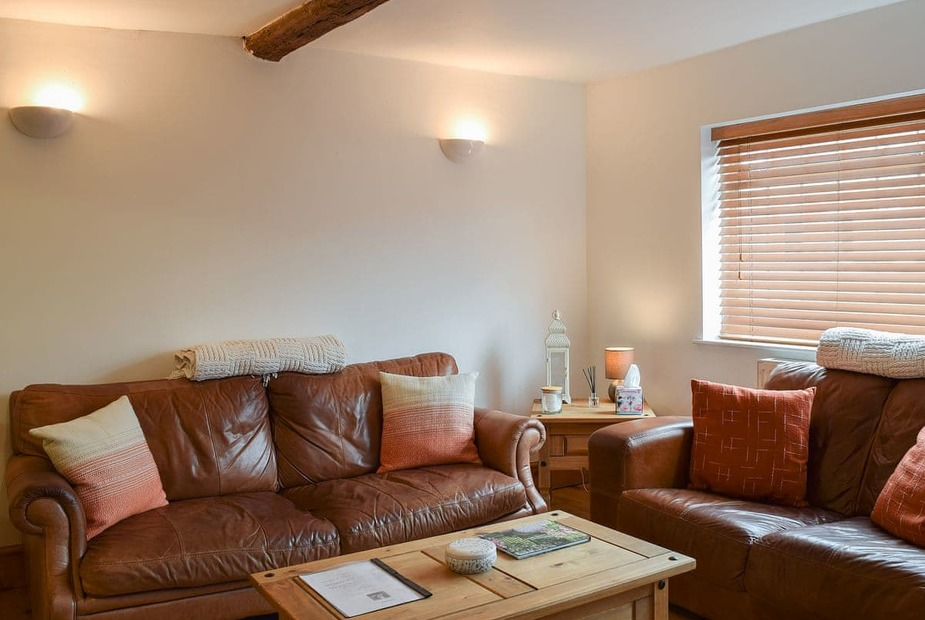 The Cottage Comfortable beamed living area | The Cottage, Stratford-upon-Avon