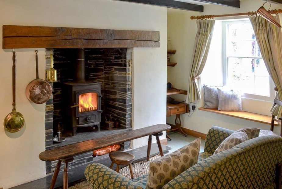 Pauntley Cottage Cosy living room with wood burner | Pauntley Cottage, St Minver, near Wadebridge