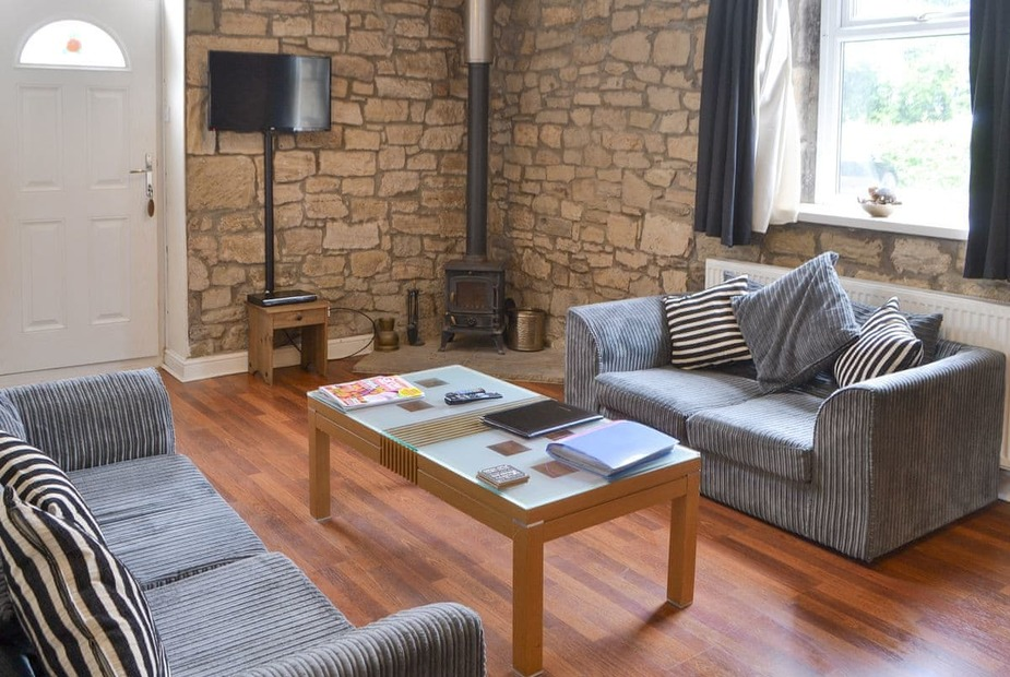 Stable Cottage Welcoming living area with wood burner | Stable Cottage - Railway Cottages, Acklington, near Amble