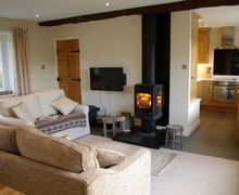 Snaptrip - Last minute cottages - Superb Satterthwaite Cottage S44054 - Contemporary woodburning stove is a lovely focal point for the lounge.