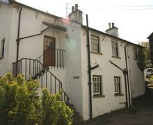 Snaptrip - Last minute cottages - Luxury Hawkshead Cottage S44076 - Gooseyfoot is set in a the main square of the village. Steps lead up to the stable door.