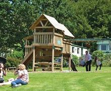 Snaptrip - Last minute cottages - Captivating Tavistock Lodge S57104 - Children's play area