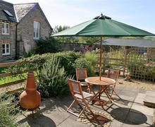 Snaptrip - Last minute cottages - Delightful South Devon Aveton Gifford Cottage S58652 - Rear patio (1)_R