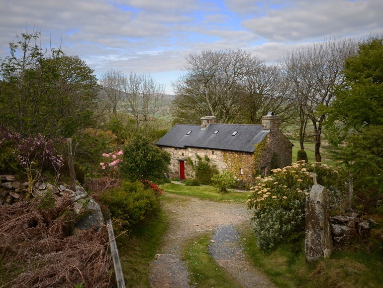 Stone cottage, down a path in remote Wales