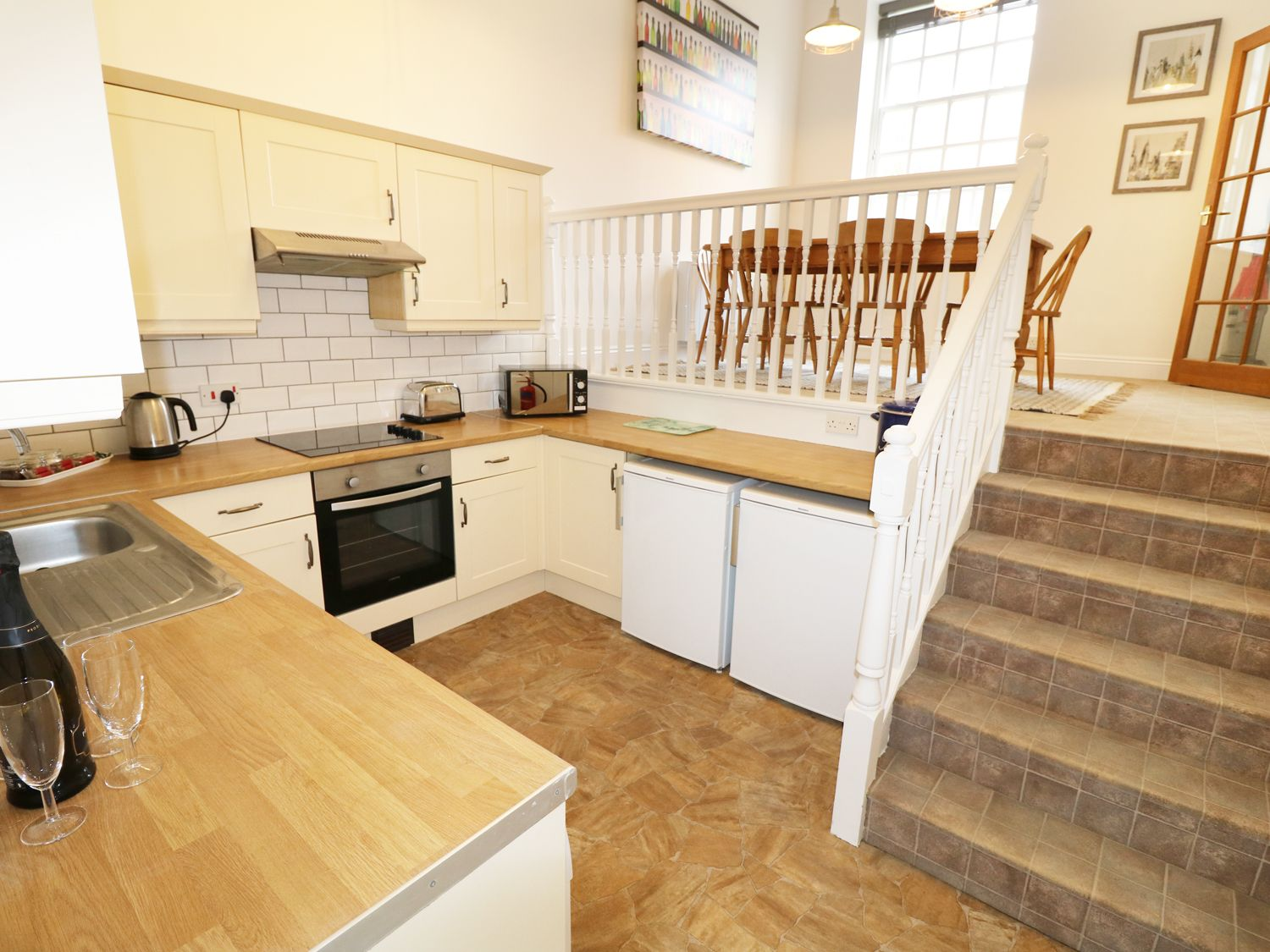 Kitchen with a dining table on a higher level