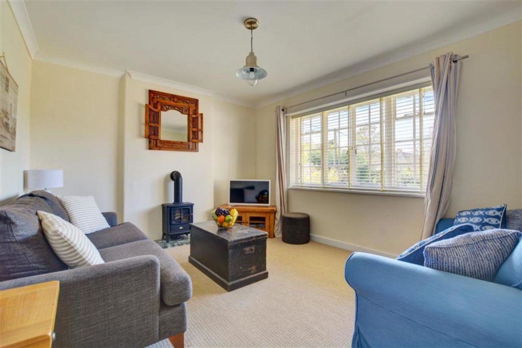 Family-friendly cottage - living room with log burner, TV and two sofas